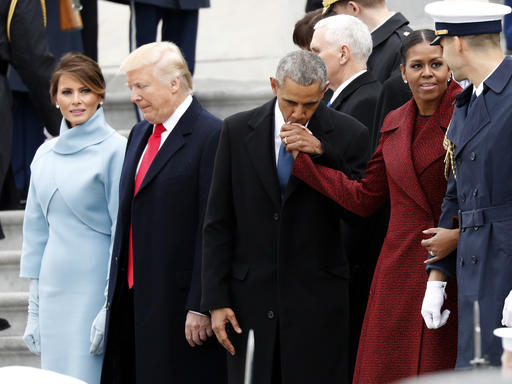 First lady Melania Trump stands with President Donald Trump as former President Barack Obama kisses the hand of his wife Michelle Obama, during a departure ceremony on the East Front of the U.S. Capitol, Friday, Jan. 20, 2017 in Washington. (AP Photo/Alex Brandon)